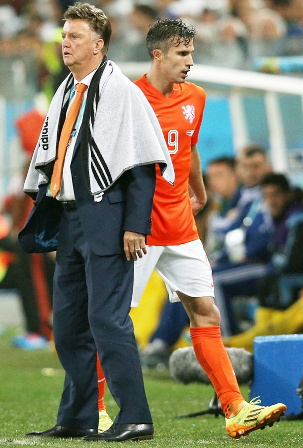 Head coach Louis van Gaal of the Netherlands looks on as Robin van Persie exits