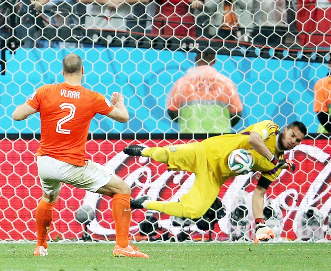 Sergio Romero of Argentina saves the penalty kick of Ron Vlaar of the Netherlands