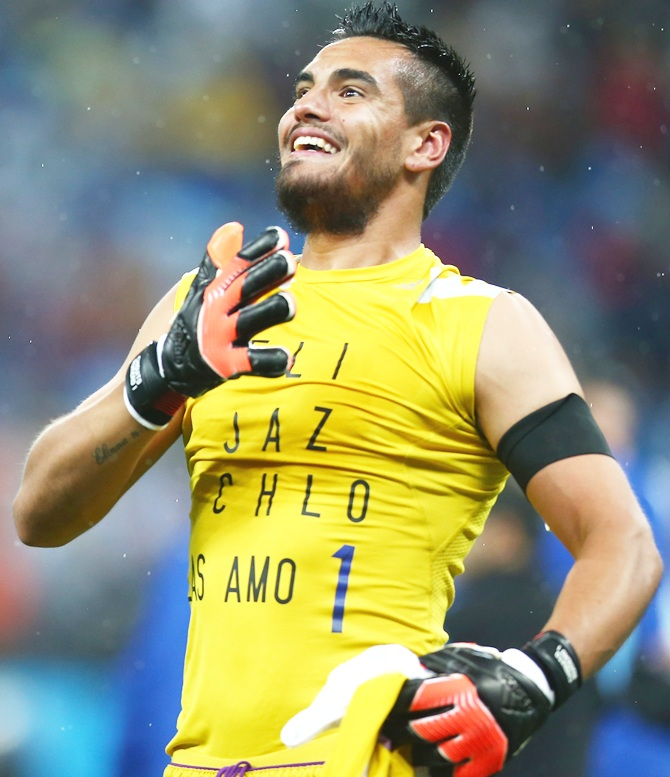 Sergio Romero of Argentina celebrates defeating the Netherlands in a shootout during the 2014 FIFA World Cup Brazil Semi Final match