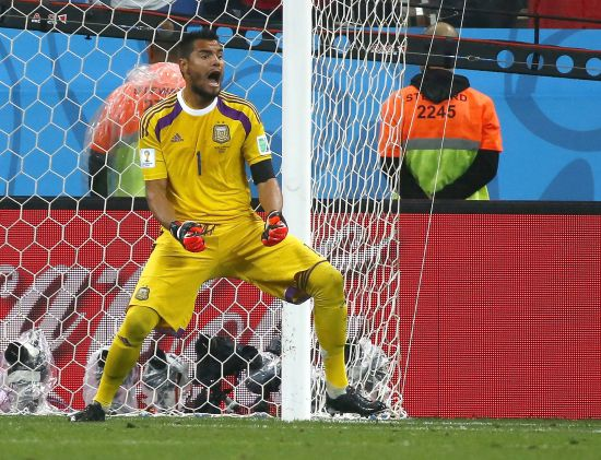Argentina's goalkeeper Sergio Romero celebrates after saving a penalty kick