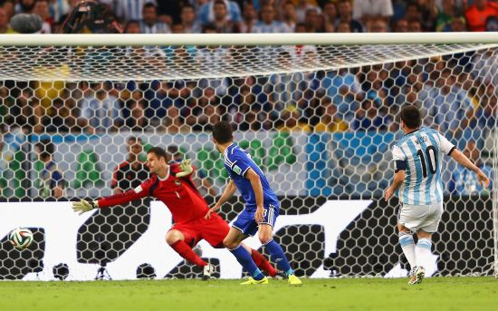 Lionel Messi scores Argentina's second goal past Asmir Begovic of Bosnia and Herzegovina