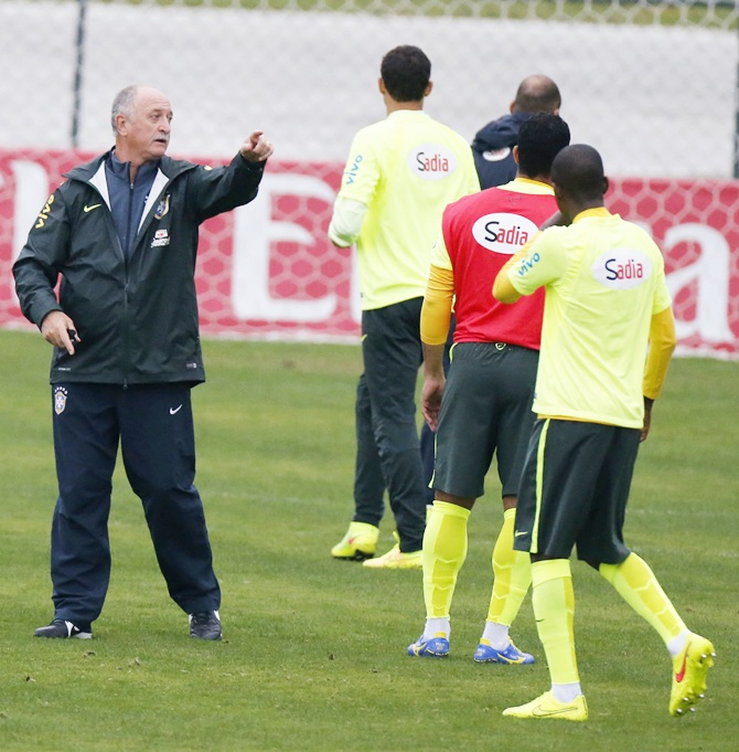 Brazil's national soccer team coach Luis Felipe Scolari, left, talks with his players during a training session in Teresopolis
