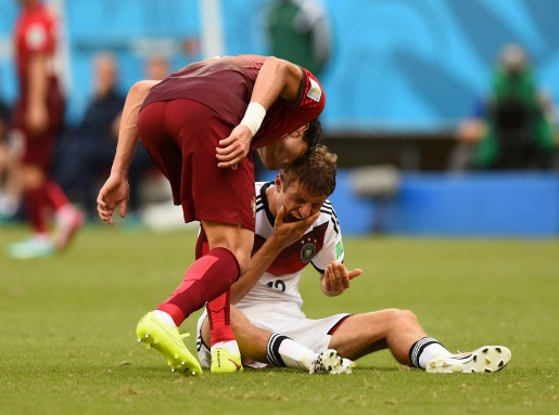 Pepe of Portugal headbutts Thomas Mueller of Germany, resulting in a red card