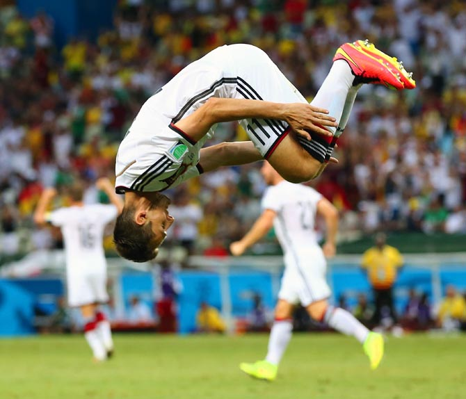 Miroslav Klose does a sommersault to celebrate scoring Germany's second goal