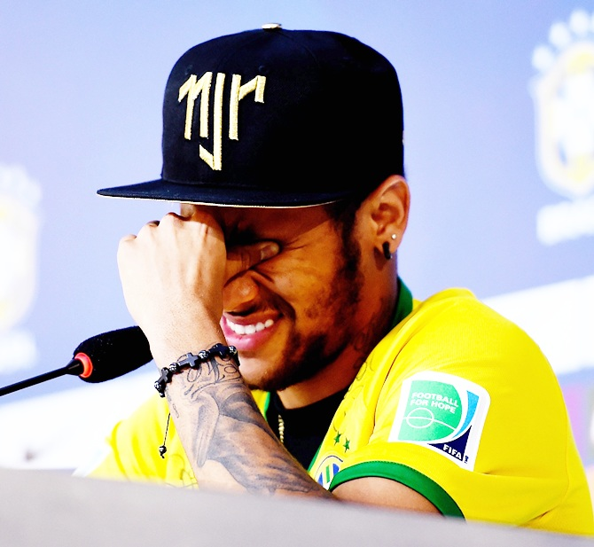 Neymar attends and speaks during a press conference in Teresopolis,   Brazil. Neymar apparently broke down in tears as he explained to the media that he was   relieved the recent accident which reportedly broke a vertebrae in his back did not leave him paralysed.