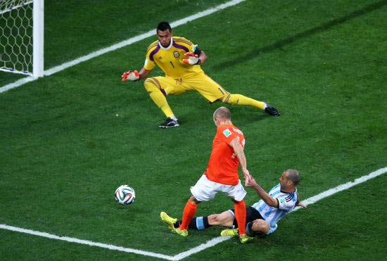 Javier Mascherano of Argentina tackles Arjen Robben of the Netherlands
