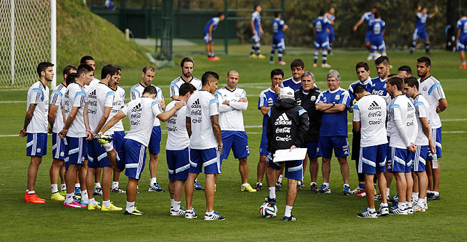 Argentina's team coach Alejandro Sabella (centre black jacket) talks to players during a training session  on Thursday