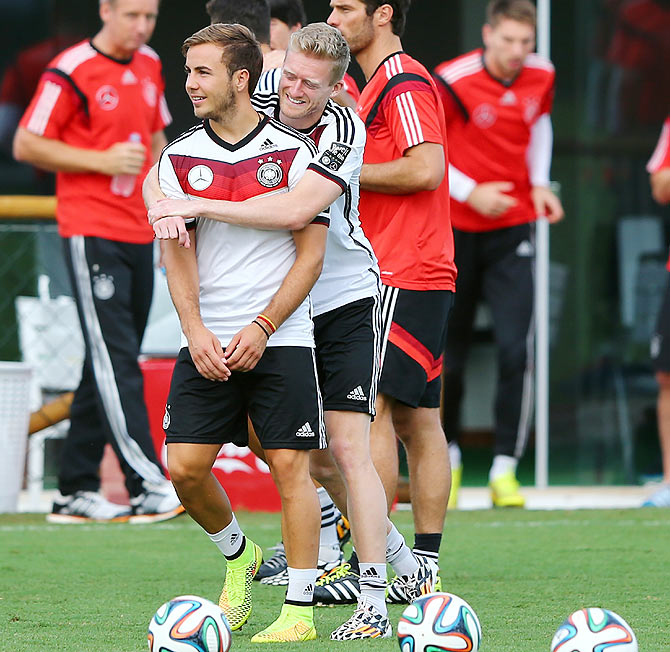 Germany's Andre Schuerrle (right) and teammate Mario Goetze share a light moment during a team training session at Campo Bahia in Santo Andre on Thursday