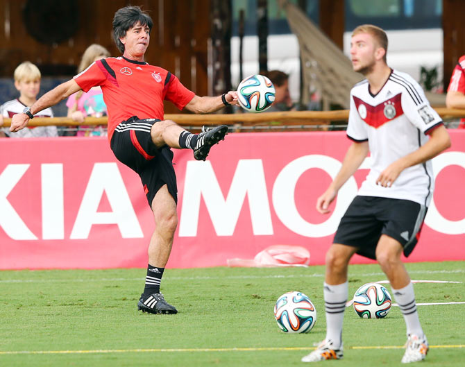 Joachim Loew, head coach of Germany (left) controls the ball during the German national team training session at Campo Bahia on