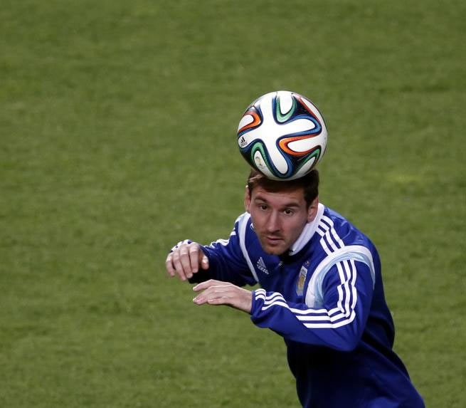 Argentina's Lionel Messi heads the ball during a training session