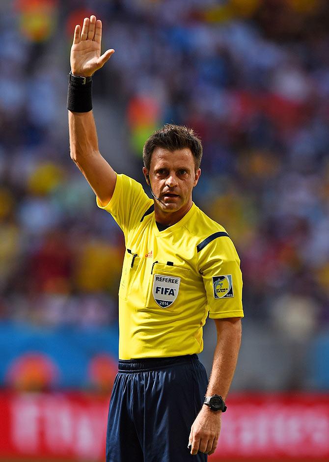Referee Nicola Rizzoli gestures