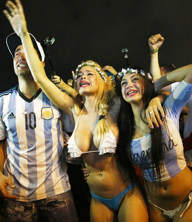 Argentina fans celebrate after their team won the 2014 World Cup semi-final match   against the Netherlands as they watched at Copacabana beach in Rio de Janeiro