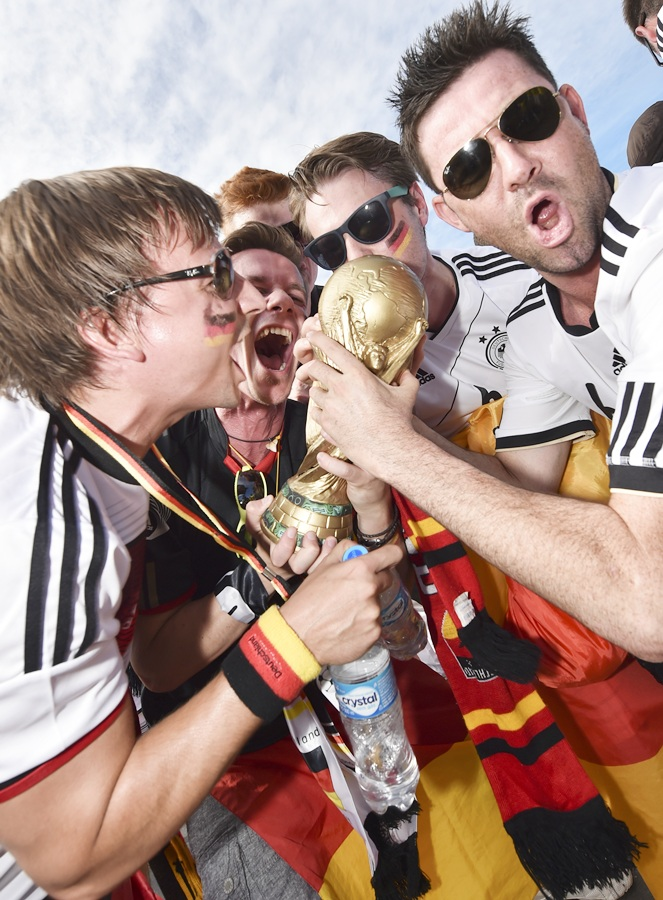 German fans pose with a replica of World Cup trophy