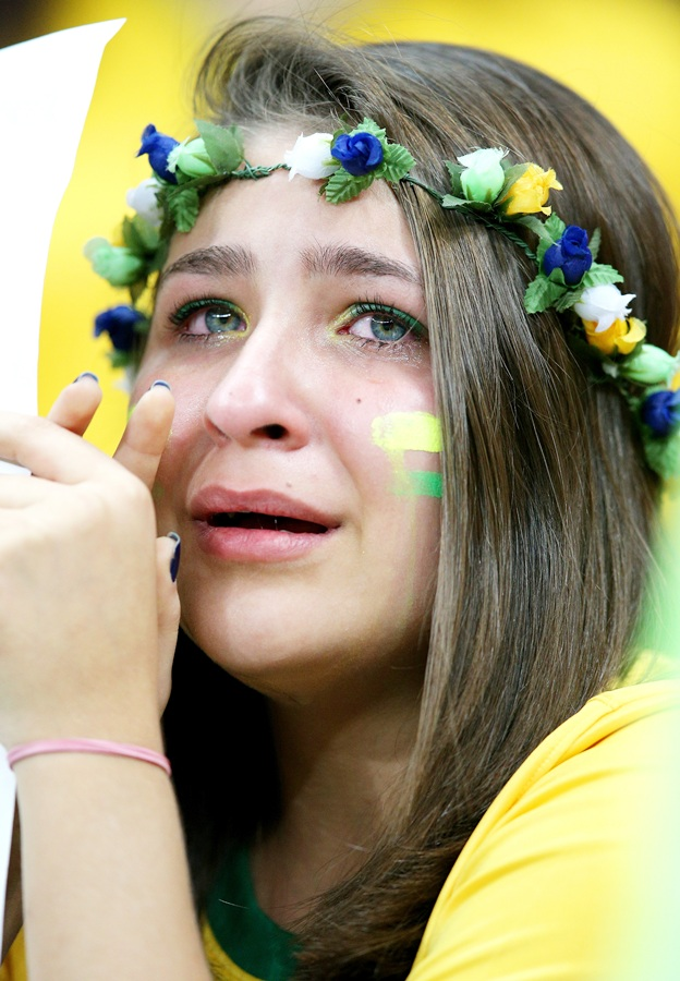 A Brazil fan cries after being defeated by the Netherlands 3-0