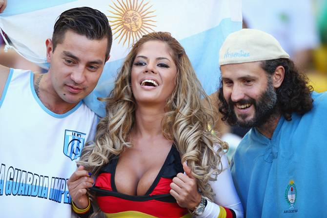 These Argentina and Germany fans enjoy the atmosphere ahead of the FIFA World Cup Brazil final