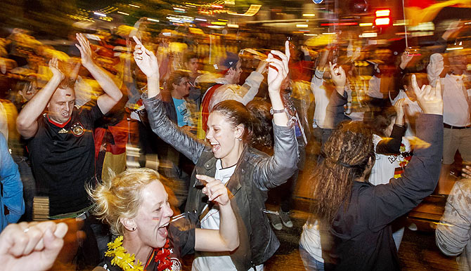 German fans celebrate at the 'Reeperbahn' red light district in Hamburg after Germany won the World Cup final against Argentina on Sunday