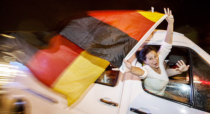 German fans celebrate as they drive along the 'Reeperbahn' red light district in Hamburg after Germany won the World Cup final against Argentina on Sunday