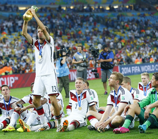 Manuel Neuer of Germany lifts the World Cup trophy with his team