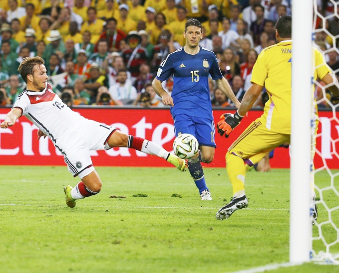 Germany's Mario Goetze shoots to score a goal past Argentina's goalkeeper Sergio Romero during extra time in their 2014 World Cup final at the Maracana stadium in Rio de Janeiro