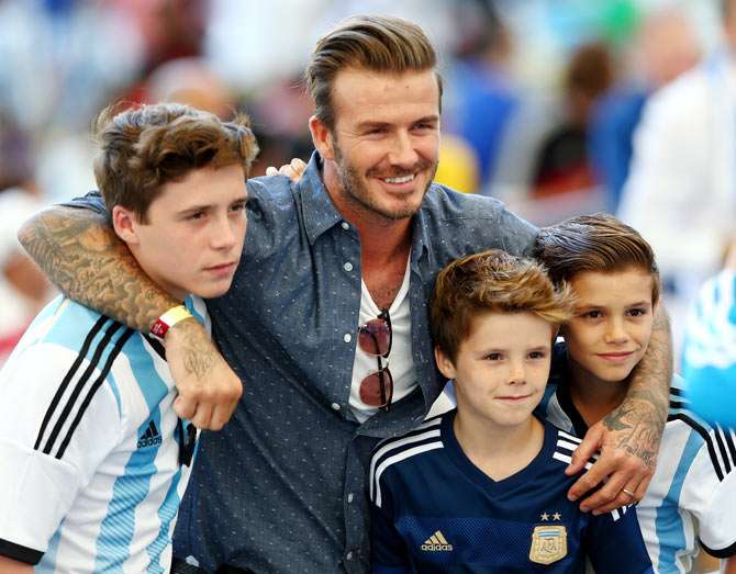 Former England international David Beckham and sons Brooklyn Beckham (left), Cruz Beckham (2nd from right) and Romeo Beckham (right) prior to the World Cup final between Germany and Argentina at Maracana in Rio de Janeiro on Sunday