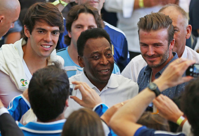 Former Brazilian international Kaka, former Brazilian international Pele and former England international David Beckham oblige fans before the start of the final on Sunday