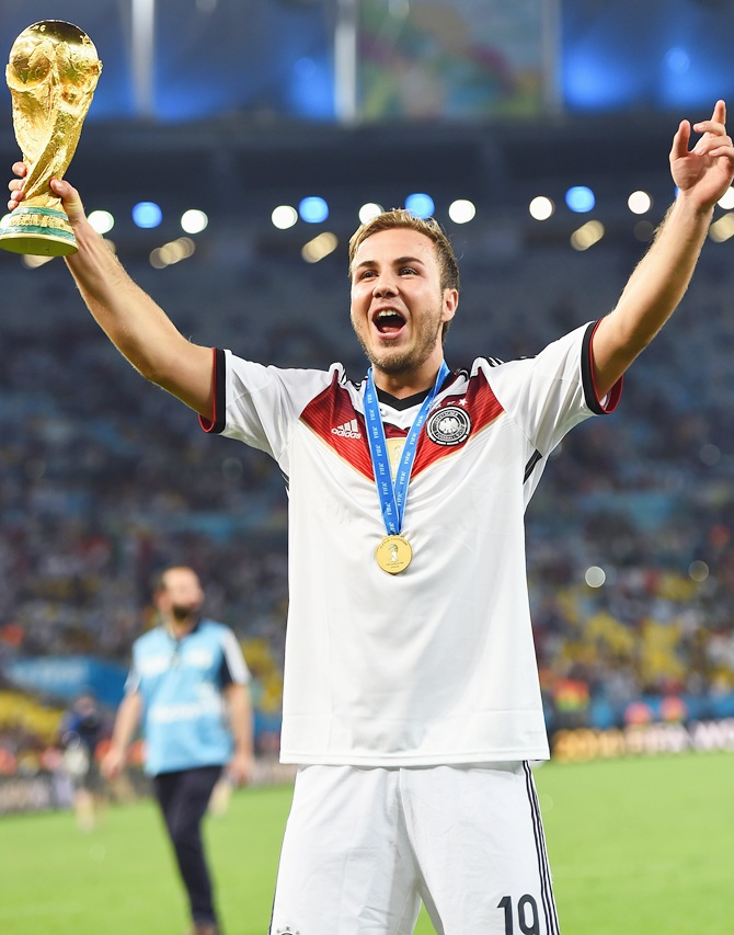 Mario Goetze of Germany celebrates with the World Cup trophy