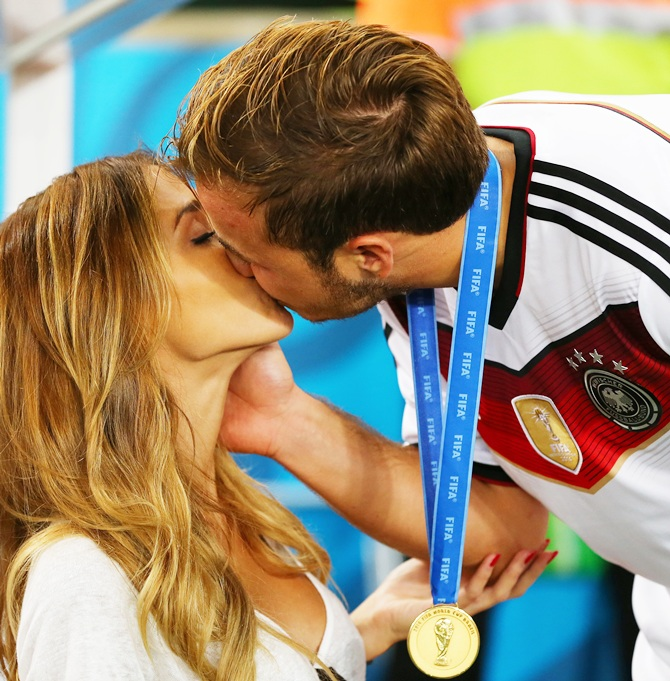 Mario Goetze of Germany kisses girlfriend Ann-Kathrin Brommel after defeating Argentina