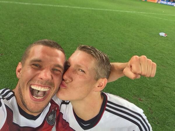 Bastian Schweinsteiger plants a kiss on Lucas Podolski