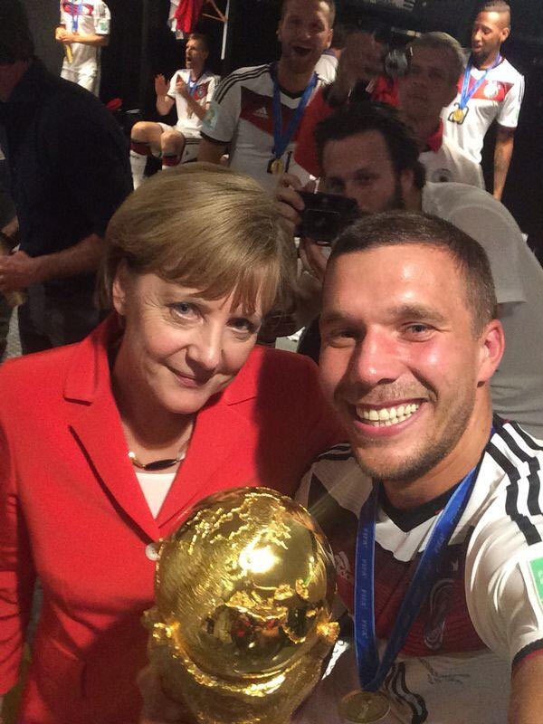 German Chancelor Angela Merkel shares the frame with Lucas Podolski