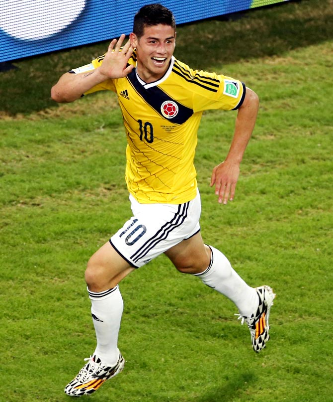 James Rodriguez of Colombia celebrates scoring his team's fourth goal against Japan