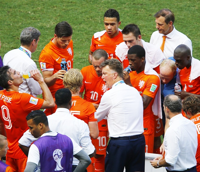 Netherlands coach Louis van Gaal, centre, speaks to his players during a cooling break