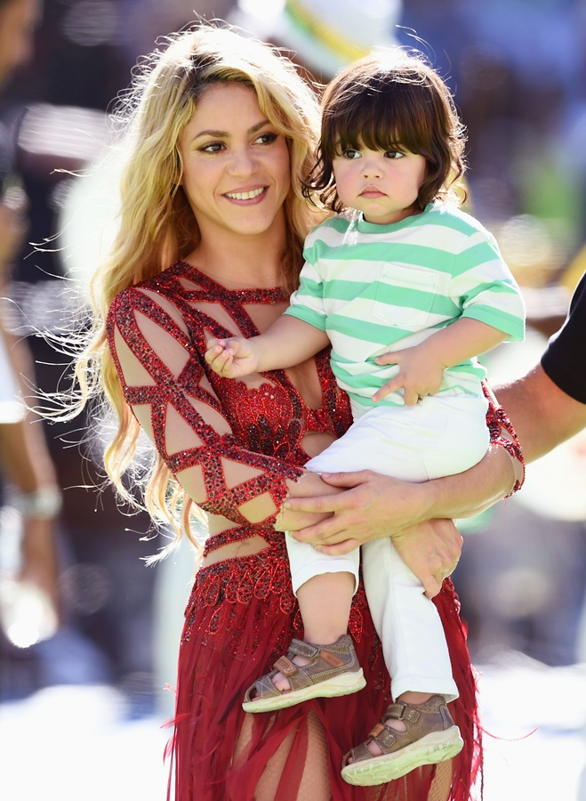 Singer Shakira and son Milan Pique look on during the closing ceremony