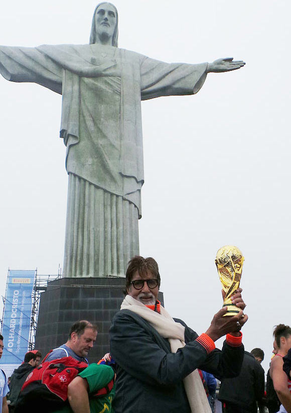 Amitabh Bachchan poses with a replica of the World Cup at 'Christ the Redeemer' in Rio de Janeiro