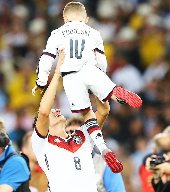 Mesut Oezil with Lukas Podolski's son