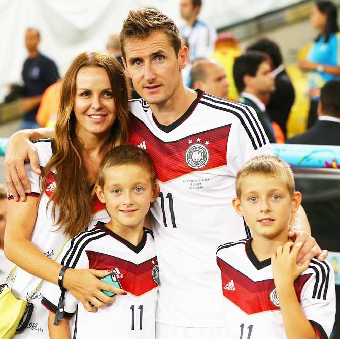Miroslav Klose of Germany celebrates with wife Sylwia Klose and their sons
