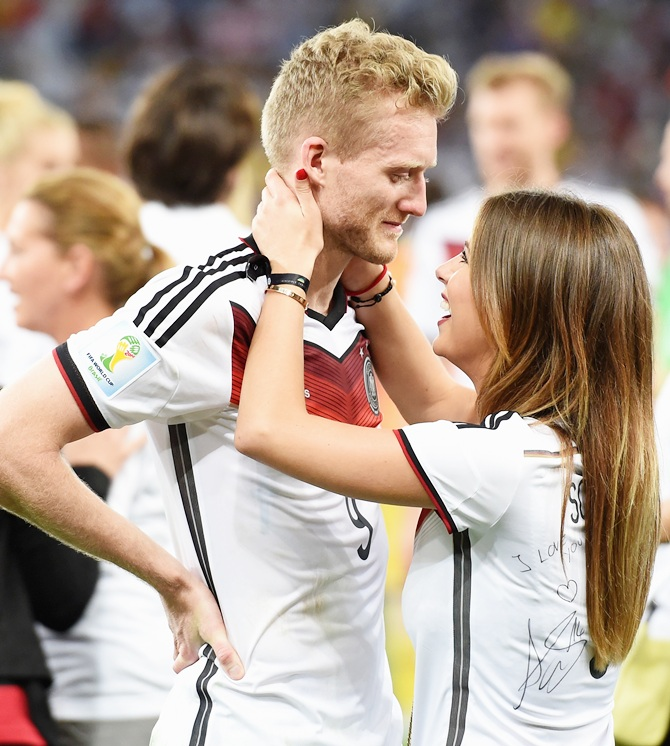 Andre Schuerrle of Germany celebrates with girlfriend Montana Yorke