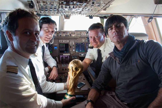 Germany coach Joachim Loew with the pilots on board the aircraft