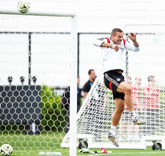 Lukas Podolski of Germany jokes around with teammates