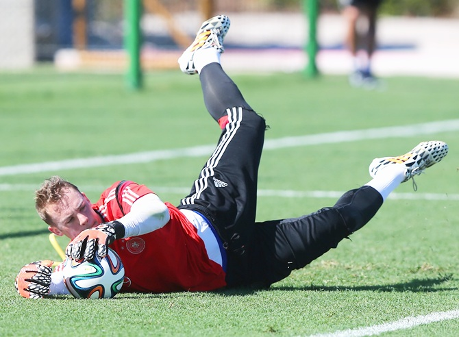 Goalkeeper Manuel Neuer makes a save during the German National team training session