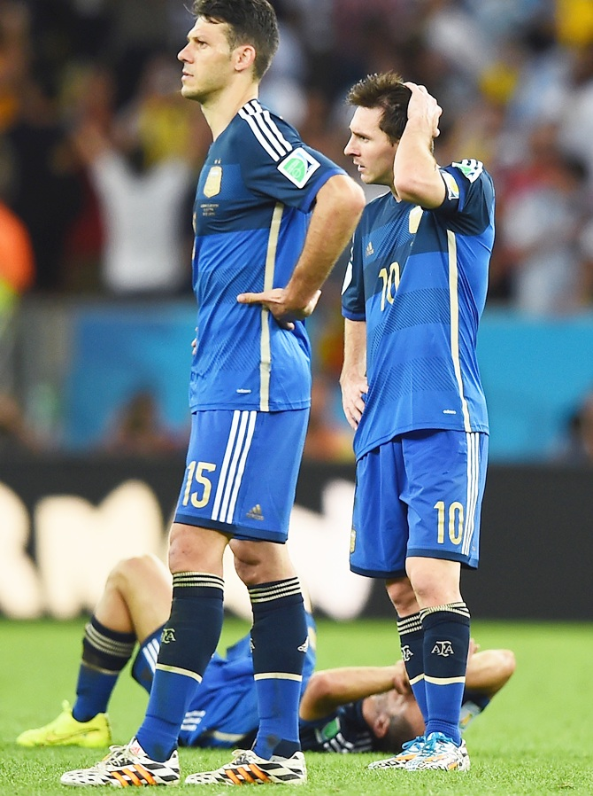 Martin Demichelis, left, and Lionel Messi of Argentina look on after being defeated by Germany 1-0