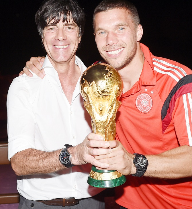 Germany head coach Joachim Loew and Lukas Podolski