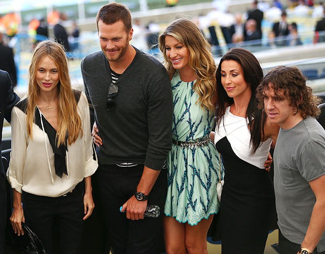 Vanessa Lorenzo (left), NFL athlete Tom Brady (2nd from left), model Gisele   Bundchen (centre) and former Spanish international Carles Puyol (right) with a guest on prior to the FIFA World Cup final on Sunday