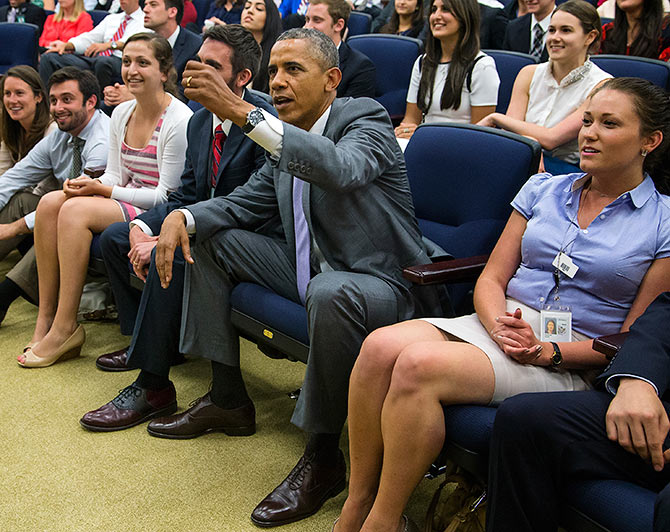 US President Barack Obama (centre) watches the World Cup match, in an auditorium at the Eisenhower Executive Office Building in Washington