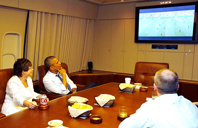 US President Barack Obama and his senior advisor Valerie Jarrett (left) the World Cup match between US and Germany while aboard Air Force One on their way to Minnesota