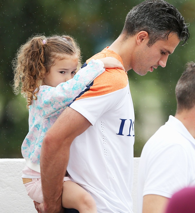 Robin van Persie holds his daughter, Dina Layla van Persie