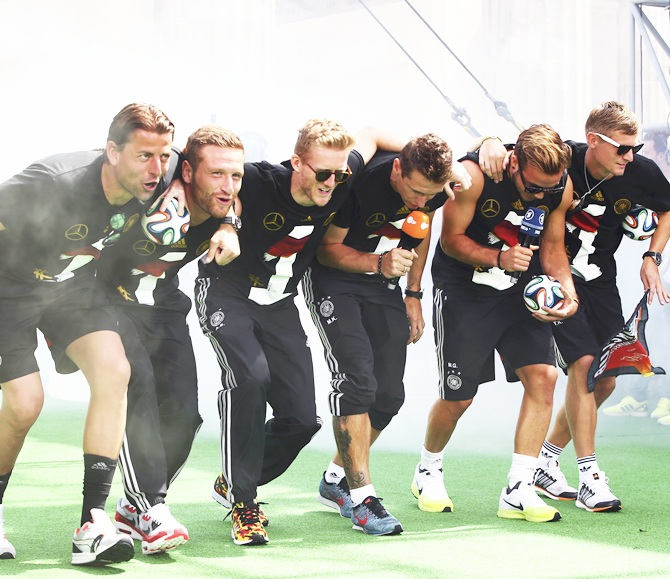 From left, Germany's Roman Weidenfeller, Shkodran Mustafi, Andre   Schuerrle, Miroslav Klose, Mario Goetze and Toni Kroos appear on stage during   celebrations to mark the team's 2014 Brazil World Cup victory