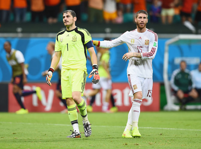 Goalkeeper Iker Casillas, left, and Sergio Ramos of Spain react after conceding a goal against Netherlands