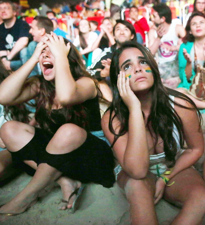 Brazil fans react after the Netherlands scored to take a 3-0 lead in extra time on Copacabana Beach