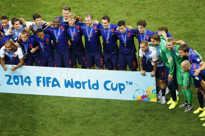 Netherlands team pose after winning the 2014 World Cup third-place playoff against Brazil at the Brasilia national stadium