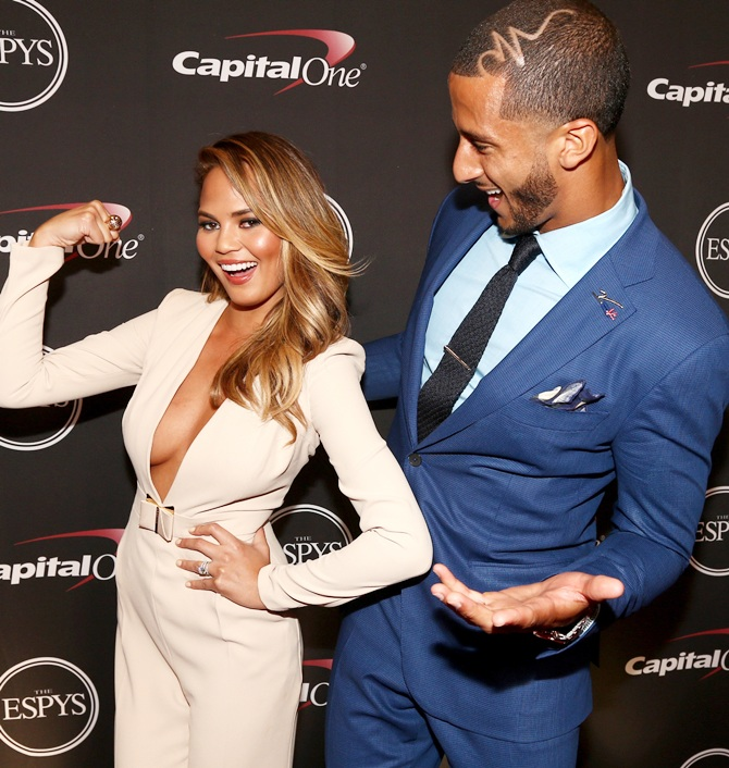 Model Chrissy Teigen and NFL quarterback Colin Kaepernick backstage at The 2014 ESPYS at Nokia Theatre